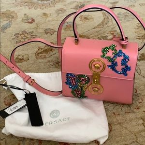 Pink Versace purse with gold hardware and jewels